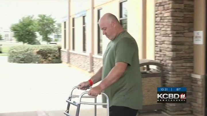 There were cheers, tears and hugs as Sgt. Shawn Wilson walked out of the facility with a walker. (Photo: KCBD screen shot) -