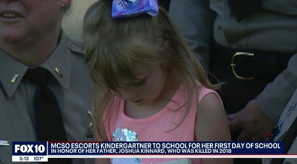 Seven-year-old Juliana Kinnard was escorted to her first day of school Wednesday by deputies of the Maricopa County Sheriff's Office and officers of the Gilbert Police Department. (Photo: Fox 10 screen shot) -
