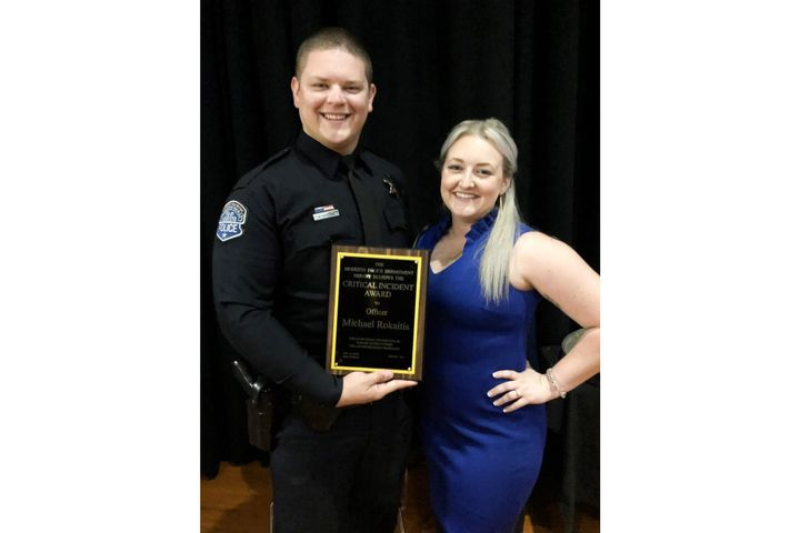 """Modesto, CA, Officer Michael """"Mikey"""" Rokaitis with his wifeMegan. Officer Rokaitis was shot Aug. 14 and now must have his leg amputated. (Photo: Modesto PD) -"""