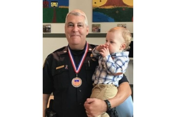 Lt. Alan Lessieur, pictured here with his grandson Asher, was named the Pepperell Police Department's Officer of the Year in 2018. He was due to retire later this year. (Photo: Pepperell PD) -