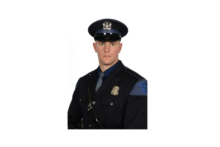 Trooper Jacob Strong of the Michigan State Police rescued a hospice patient from a burning home Wednesday night. (Photo: Michigan State Police) -