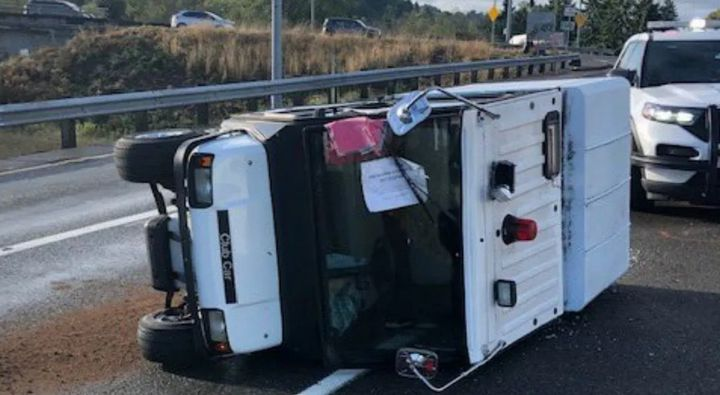 Washington State Patrol troopers used a PIT maneuver Sunday to prevent a woman driving a golf cart from entering the freeway. (Photo: WSP/Twitter) -