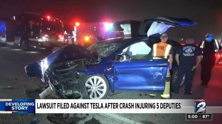 Five law enforcement officers were injured in this crash involving a Tesla. Their attorneys say the driver was DUI and using Autopilot. (Photo: Click2Houston screen shot) -