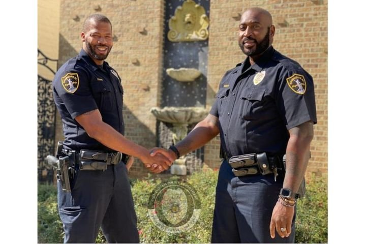 Birmingham Officers Evans and Burnett pulled a drowning woman from a vehicle submerged in flood waters last week. (Photo: Birmingham PD) -