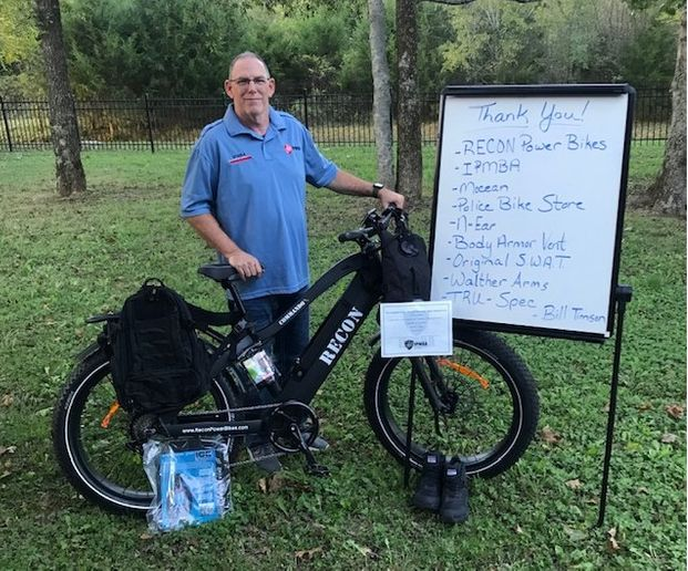 """Sgt. Bill Timson with some of the products he won in POLICE's """"Outfit the Bike & Motor Officer"""" contest. -"""