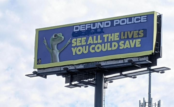 Indecline, who labels themselves a guerrilla activist art collective, altered two Geico ads on I-40 Monday. On Saturday a Memphis officer died on the same interstate. (Photo: Indecline) -