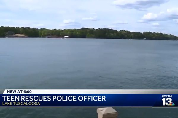 Grady McClendon pulled a Tuscaloosa police officer to safety after the officer's patrol boat was pulled under water.  - Screen grab of news report.