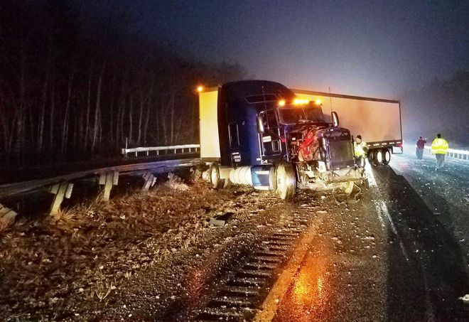 A Maine state trooper was injured early Friday morning when his patrol vehicle was hit by a tractor-trailer truck. (Photo: Maine State Police)  -