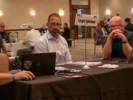 Delegates and supplier hosts at face-to-face meetings.