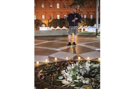 Michael McCann of the Virginia State Police stands in front of the Memorial's emblem and plays...