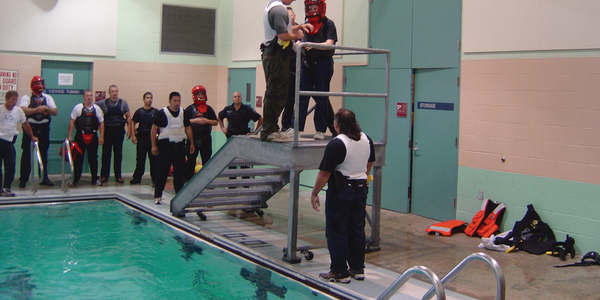 Training wearing full gear in the water will help officers prepare to swim with extra weight...
