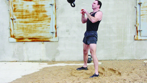 Jeff Martone of Tactical Athlete performs high-intensity kettlebell swing and catch...
