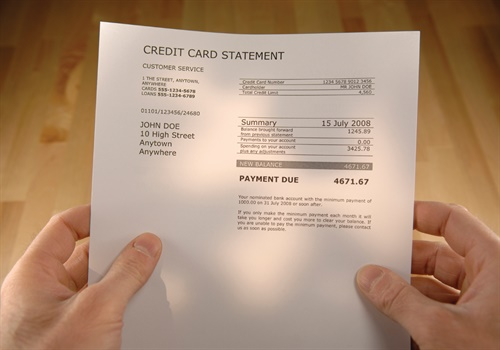 Credit card interest is a common destructive expense that pushes you toward poverty and away from prosperity. Photo: Getty Images