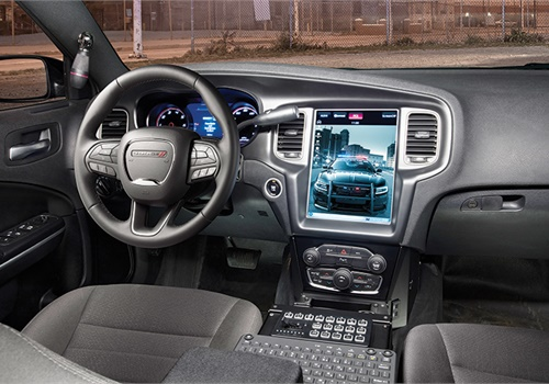 The UConnect touch screen display is mounted in the dashboard of a Dodge Charger Pursuit.