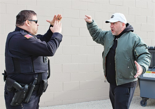 """Having your hands up, in front of you using the """"emergency time out"""" position allows you to communicate a message of non-violent intentions without compromising officer safety. Photo: Dave Young"""