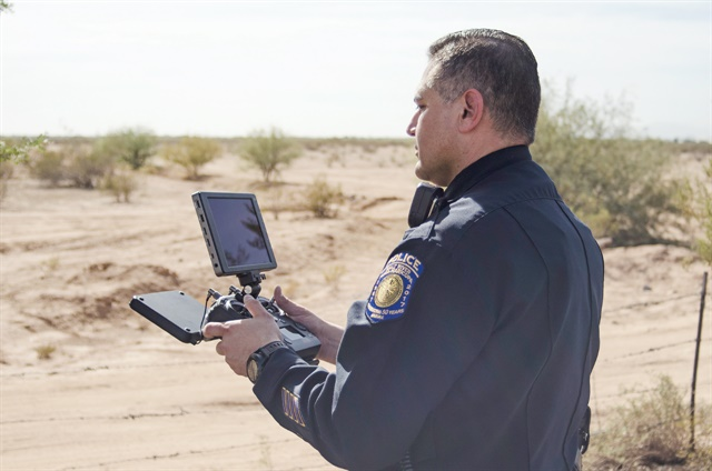 An officer is using a DJI Cendence controller with a DJI CrystalSky monitor to operate his agency's UAS, or drone. Photo: Michael Hamann