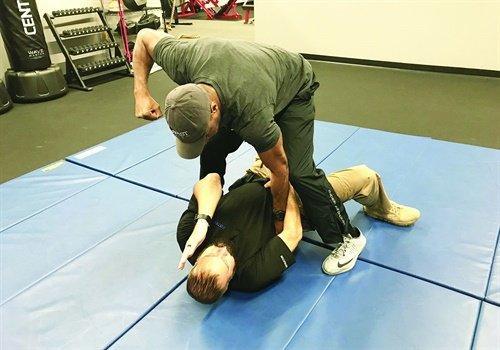 You can use a modified power lock from the ground. You don't need to worry about your balance. Completing the move pulls the attacker down to the ground.Photos: Dave Young