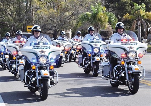 Motor units are often locked into traditional roles such as providing motorcade escorts. Photo: Amaury Murgado