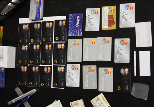 Thieves take a blank credit card, emboss it with a name matching a driver's license and load a victim's information onto the magnetic stripe.Photo courtesy of OCATT.