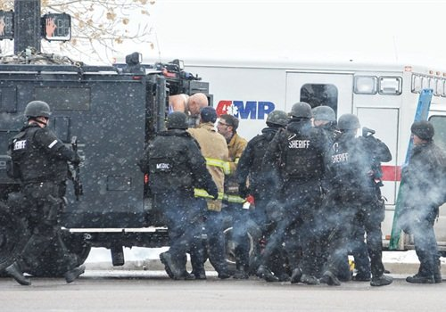 In Colorado Springs officers used armored rescue vehicles to remove wounded from the Planned Parenthood Building and ferry them to waiting ambulances. (Photo: Zuma Press)