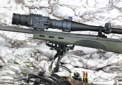 This rifle is equipped with an integral rail on the barrel. If yours doesn't have one, a gunsmith can add a second short rail to your bolt-action rifle to facilitate easy-on-and-off of a forward-mounted thermal device.