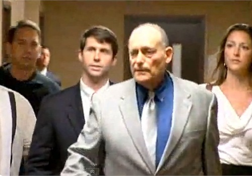 Special Agent Chris Deedy (second from left) appears in court on murder charges. Screenshot via KITV.