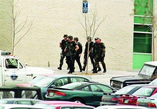 A SWAT unit exits Columbine High School after sweeping the campus for suspects and victims. Photo: Newscom.