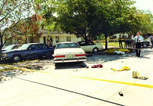 Crime scene photo of the infamous FBI Miami shootout, showing suspect and agents' vehicles and battle debris. Photo: Miami-Dade PD.