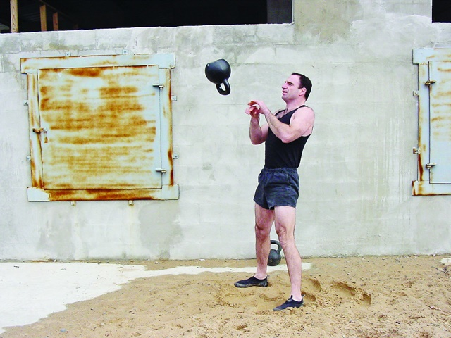Jeff Martone of Tactical Athlete performs high-intensity kettlebell swing and catch exercises. Photo: Jeff Martone