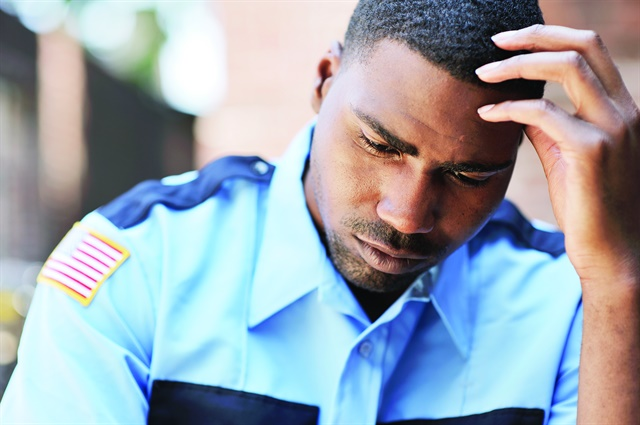 Many officers have a hard time finding somebody to talk to about what they are coping with. And most don't want to have to relive what precipitated the problem. Photo via Getty Images.