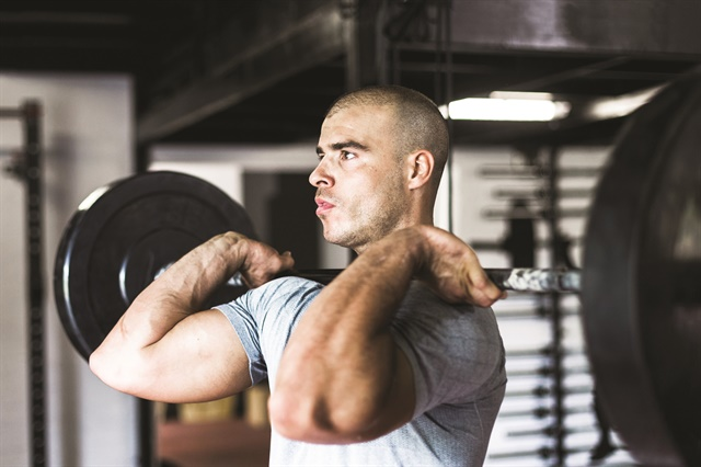 "For LEOs especially, free weights are much better for building ""real world"" functional strength than the machines you find at the gym. (Photo: Getty Images)"