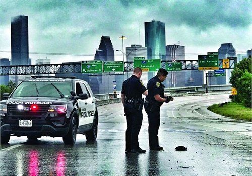 "To maintain both officer and citizen safety as much as possible, Houston officers were working in a minimum of two-person teams in ""cage cars"" so they would have enough people on hand to help anyone they encountered as well as handle any other situations that might occur. Photo: Houston PD/Flickr"