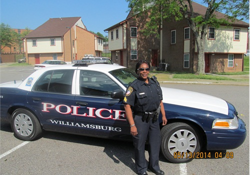 "Sgt. Kim Hamilton of the Williamsburg PD drives through a housing complex: ""Criminals know you can try to come through [Williamsburg]—but we'll catch you."" (Photo: Kristine Meldrum Denholm)"
