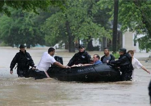 Nashville Police officers used military surplus boats to rescue residents during severe flooding in 2010. Photo courtesy of NPD.
