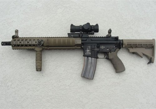 A 2012 AR-15 patrol rifle now comes with a 1913 quadrail, back-up iron sights, co-witnessed optic, vertical foregrip, QD sling swivels, and proprietary flash hider. Photo: Bob Parker