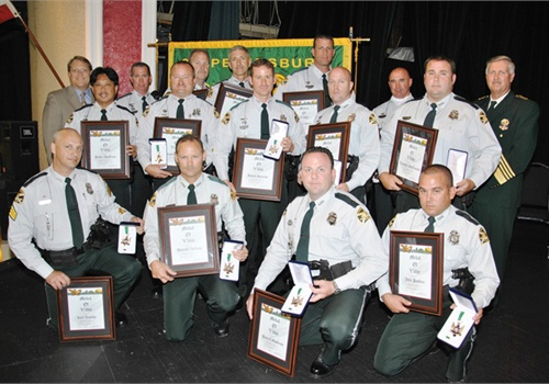 Sgt. Karl Lounge, front row, first on left; Officer Darrell Goodrow, front row, third from left; Officer Doug Weaver, second row, second from left; Officer Tim McClintick, second row, far right; Officer Max McDonald, back row, second from right. Photo: St. Petersburg (Fla.) PD.