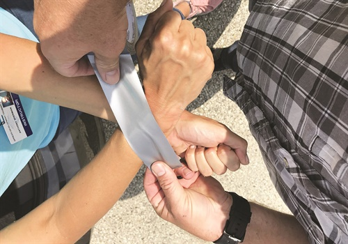 Crossing your wrists when an abductor binds them with tape will provide you with more leverage. (Photo: Anthony and Tracy Sherman from Genesis Group)
