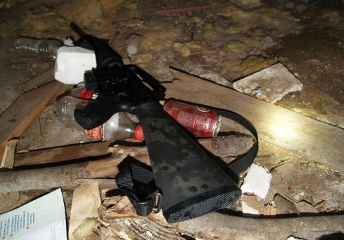 Investigators found an AR-15 hidden under a floorboard in the bedroom of the Mercado home. Photo courtesy of Oklahoma City Police Department.