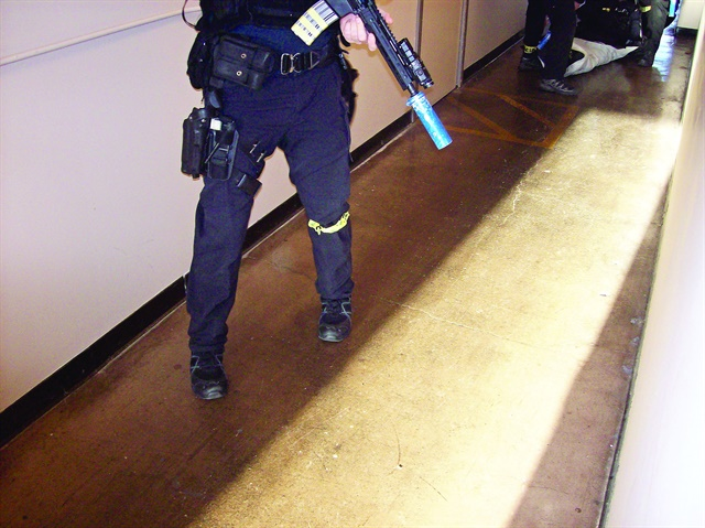 "A Seattle SWAT officer was impressed his Haix boots were quiet on normally ""squeaky flooring"" when wet. Photo: Seattle PD SWAT"