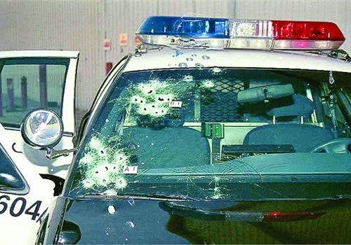 Three 12-gauge bursts struck the passenger side of Officer Lavoie's cruiser. Photo: Officer Lavoie.