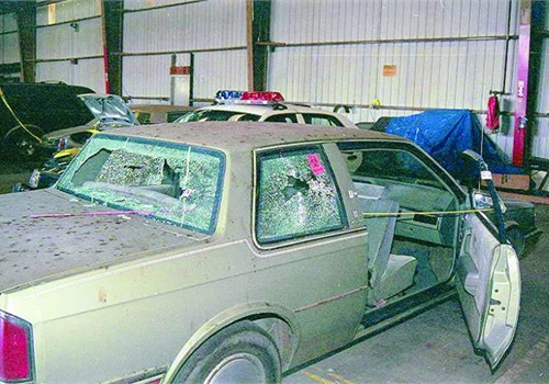 The suspects' car was battered by numerous shots from Officer Lavoie. Photo: Officer Lavoie.