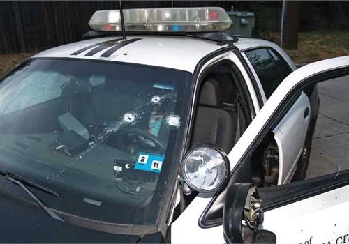 Officer Lawson's patrol car was hit numerous times; six rounds struck the officer. Photo courtesy of Oklahoma City Police Department.