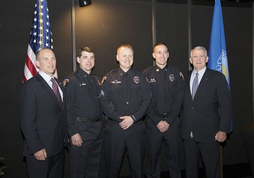 Brownells CEO Pete Brownell, Sgt. Adam Olson, Sgt. Chris Shine, Officer Cody Jacobsen, and Col. Oliver North at the NRA Officer of the Year award event.