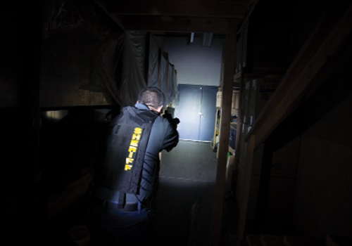When conducting a search with a flashlight, you still face threats from areas that are not illuminated. (Photo: Edward M. Santos)