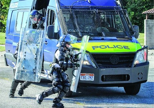 Specialized public order vehicles carry officers and their equipment to sites where crowd control is needed. (Photo: Geoff Perrin)