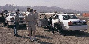 Performance Review--Road Testing the 2002 Cop Cars