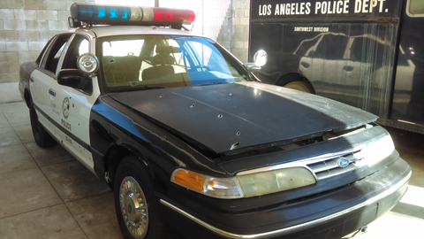 LAPD patrol car with battle damage from the North Hollywood Shootout. Photo: Los Angeles Police...