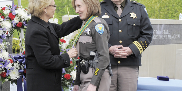Then-governor Christine Gregoire presented the Washington Law Enforcement Medal of Honor to...
