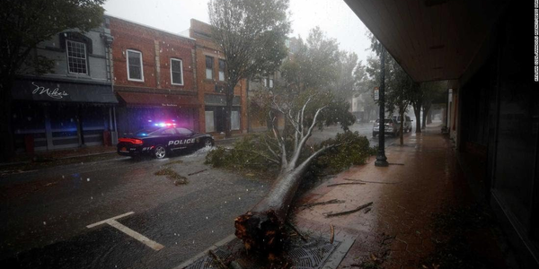 New Bern officers dealt with flooded and tree-blocked streets as they tried to help residents...