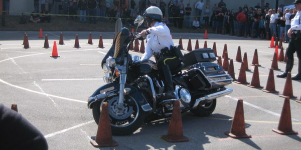 Sanford (Fla.) PD's Officer Tina Leman weaves through traffic cones on her H-D Electra Glide at...